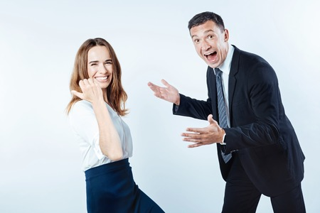 Extremely happy business people celebrating successful project
