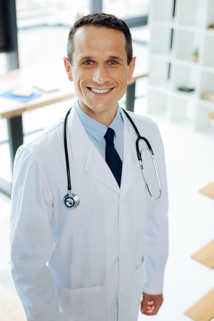 Delighted happy doctor wearing a stethoscope Stock Photo
