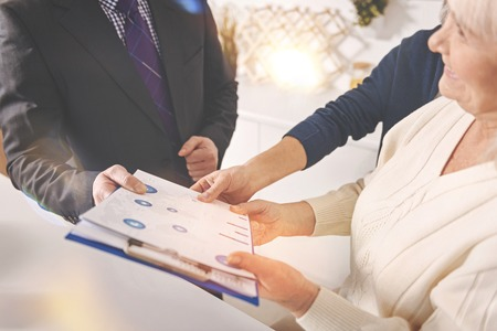financial planning married: Positive old couple consulting with insurance agent Stock Photo