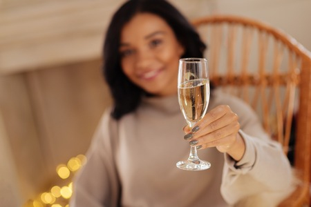 Smiling woman holding a glass of champagne Stock Photo