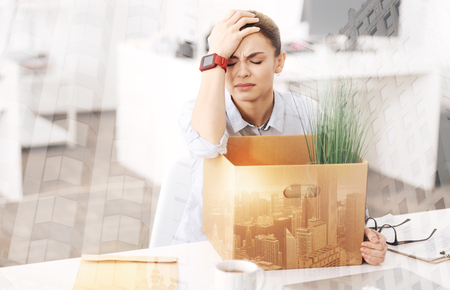 dismissed: Depressed unemployed woman sitting in the office