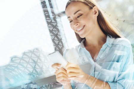 impression: Positive good looking woman clicking the telephone Stock Photo