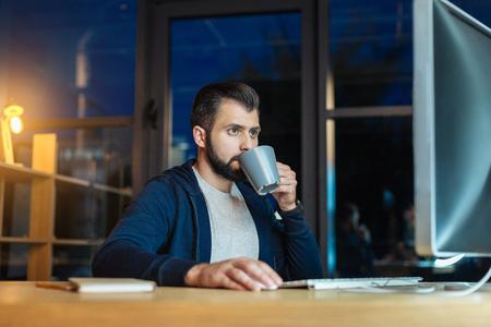 Attractive brunette drinking hot tea