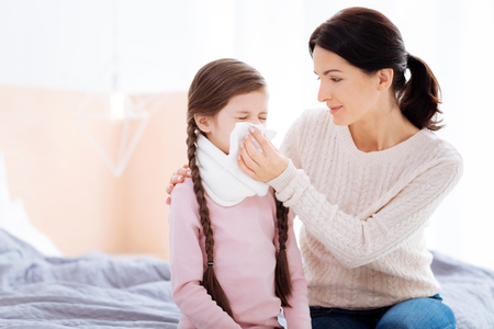 Kind woman holding a napkin for her daughter