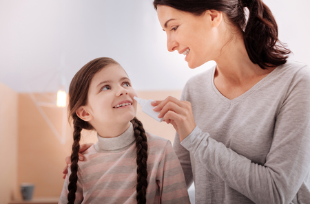 Cheerful smiling relatives with nasal drops Stock Photo