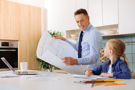 Delighted smart engineer working at home