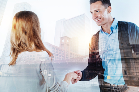 Pleasant man getting acquainted with his new coworker Stock Photo
