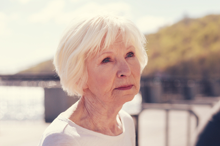Close up of charming senior woman with a wistful look Stock Photo