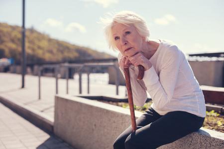 Fragile elderly lady feeling lonely Stock Photo