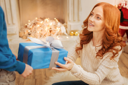upbringing: Loving mother giving her son christmas gift