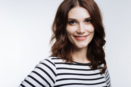 Portrait of beautiful smiling woman in striped pullover