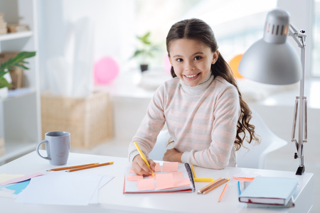 upbringing: Joyful delighted girl looking at you Stock Photo