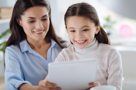 Cute young girl looking at the tablet screen Stock Photo