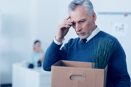 dismissed: Stressed retire man leaving his office