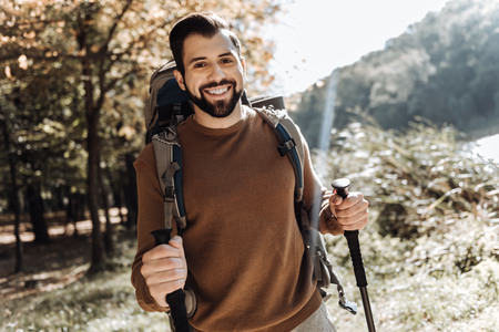Optimistic man with a rucksack