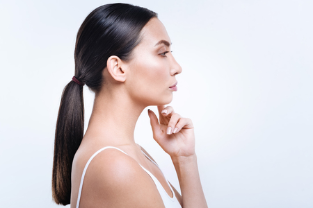 Side view of a beautiful dark-haired woman with pony tail