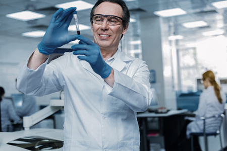 Smart genius scientist looking at the vaccine Stock Photo