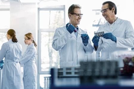 Joyful smart scientists working in team