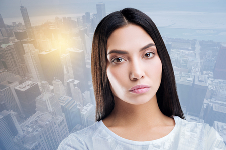 Deep stare. Thoughtful woman posing on camera while working in model agency Stock Photo