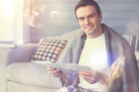 Productive start. Committed professional positive man deciding working from home and doing the job wearing cozy pajamas Stock Photo