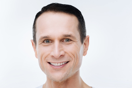 Happy face. Portrait of a happy nice delighted man smiling while looking at you Stock Photo