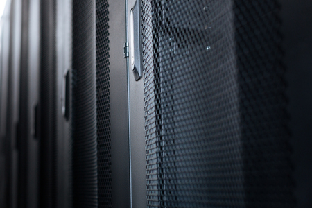 Important cabinets. Black metal stylish modern server cabinets in a data center Stock Photo