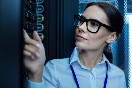 Determined thoughtful woman thinking and looking at the equipment Stock Photo