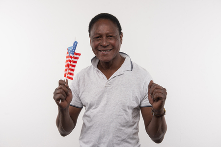 My country. Happy nice Afro American man smiling while expressing his patriotic feelings Stock Photo