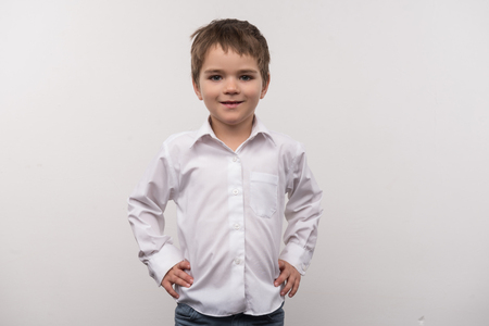 Pre school age. Nice smart boy smiling while looking at you Stock Photo