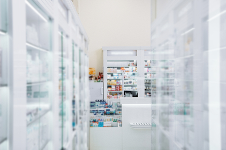 Inside drugstore. Light showcase stretching along walls and situating in drugstore Stock Photo