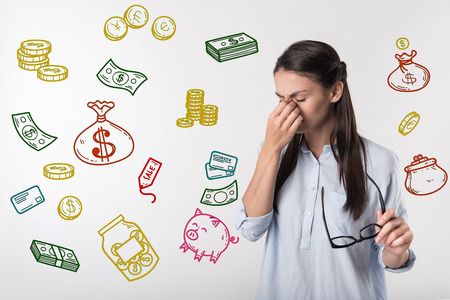 Financial situation. Unhappy young woman becoming unemployed and thinking about her financial situation 版權商用圖片
