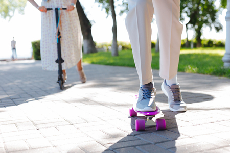 My hobby. Close up of a violet skate being used for skating in the park Фото со стока