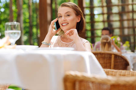 Prosperous businesswoman. Prosperous experienced businesswoman calling her partner asking him about upcoming meeting