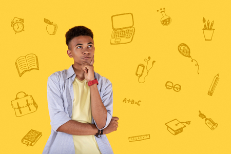 Boring studies. Tired clever person looking into the distance and feeling bored while having an easy task at the lesson of mathematics Stock Photo