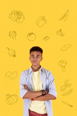 Hungry person. Calm young boy standing with his arm crossed and thinking about food while being hungry Stock Photo