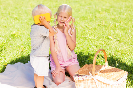 Smiling faces. Happy cheerful kids laughing while playing together Stock Photo