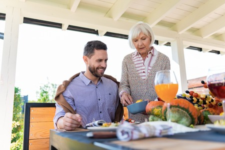 Healthy food. Cheerful male person expressing positivity while going to have dinner Stock Photo
