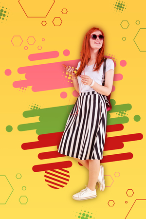 Favorite playlist. Red-haired fashionable beaming girl wearing long striped skirt listening to her favorite playlist Stock Photo