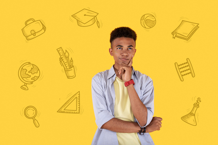 Boring education. Emotional student standing with his arms crossed and feeling bored and thinking about his education Stock Photo