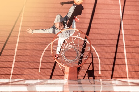 On the sportsground. Top view of a basket hanging around the basketball ground Stock Photo