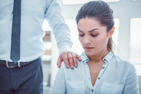 Boss touching secretary. Man in official clothes putting his hand on woman shoulder without permission