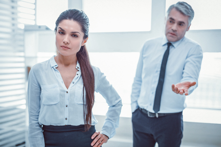 Confused superior. Unpleasant boss failing in understanding problem with his female colleague