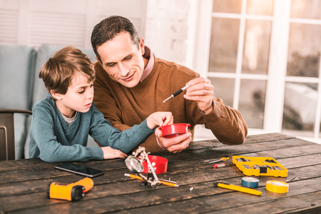 Interesting tools. Little boy learning fun things about engineering. Imagens - 112693127