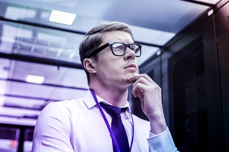 Intelligence agency. Portrait of a thoughtful smart CIA agent thinking about his case Banco de Imagens