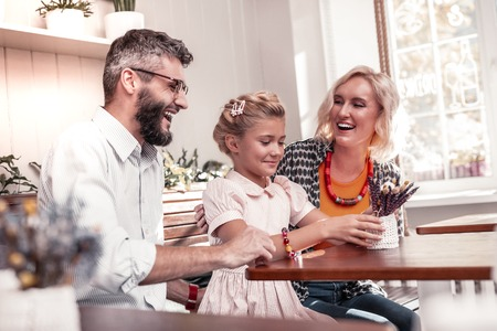Happy moments. Cheerful positive family laughing while having lots of fun together Reklamní fotografie