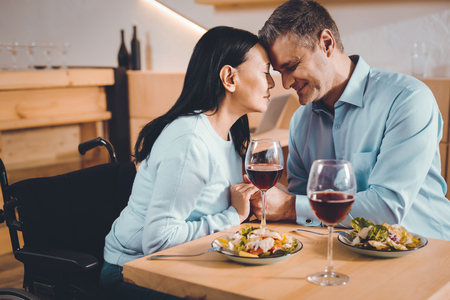 Spread love. Enamored happy couple having a romantic dinner in a restaurant Imagens