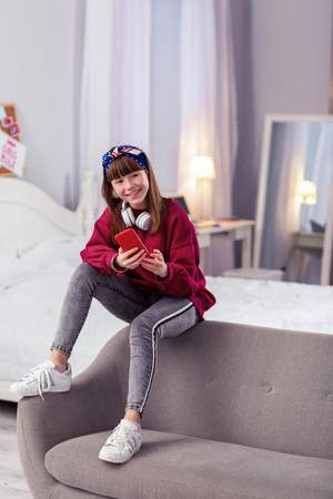 Sport style. Kind teenager expressing positivity while dreaming about birthday party Imagens