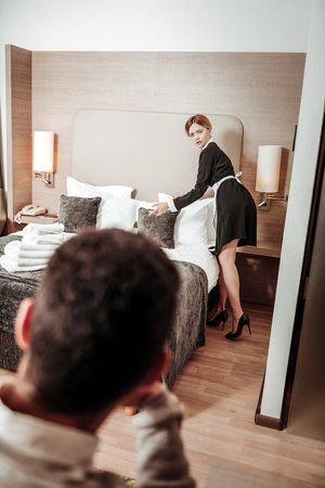 Maid concerned. Hotel maid feeling extremely concerned after seeing client watching her