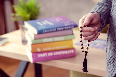 Magic properties. Selective focus of a male hand holding a string of beads