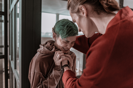 Extremely terrified. Green-haired girlfriend feeling extremely terrified of aggressive crazy boyfriend